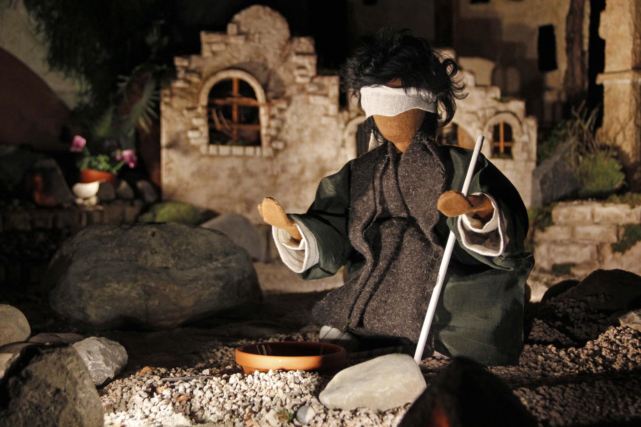 Als Jesus mit seinen Jüngern unterwegs war, sah er einen Mann, der seit seiner Geburt blind war.