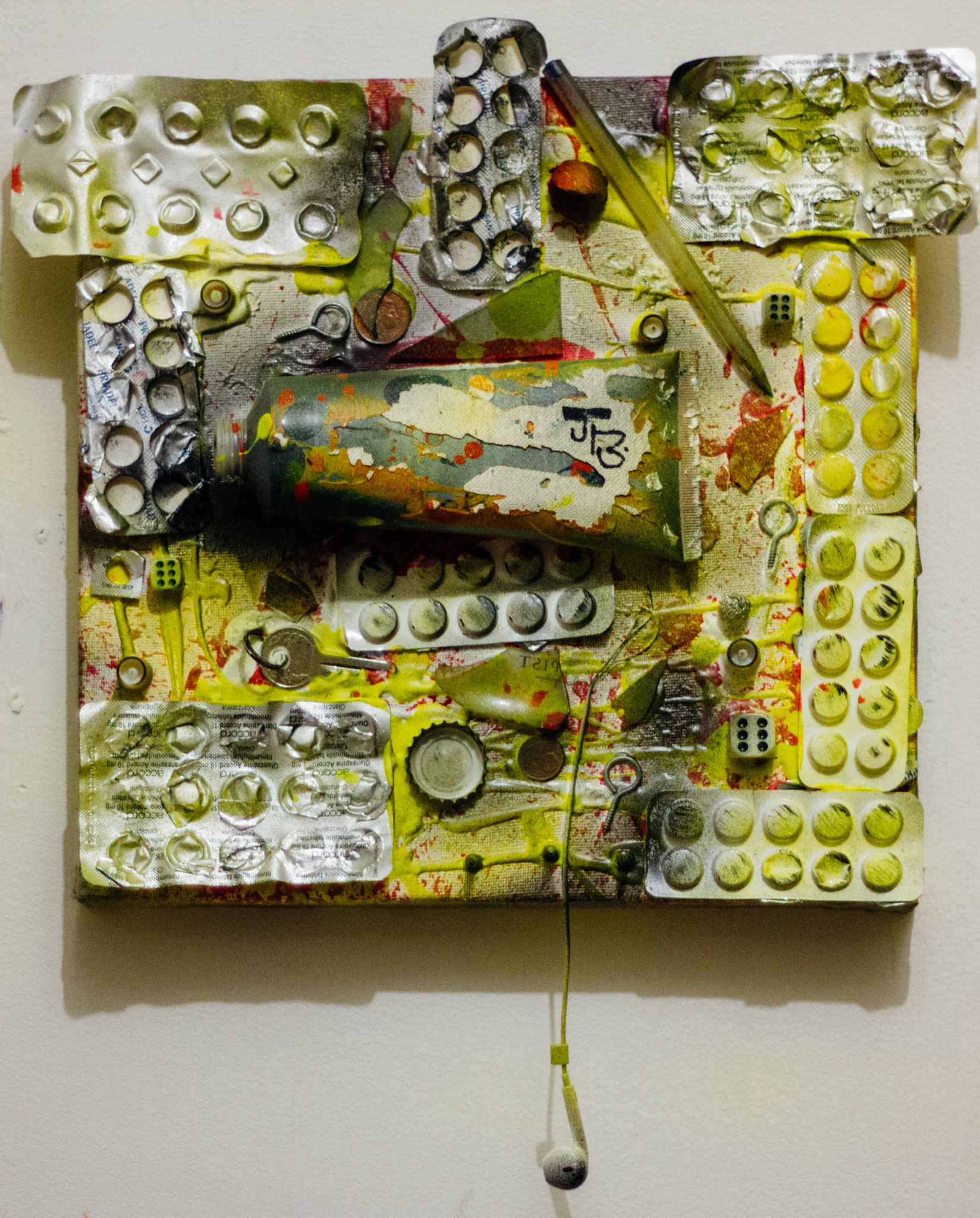 """50. """" Manic D. """" (30 x 30cm) Acrylic & spray paint + empty medication packages + objects on canvas. 2016        (€760)"""