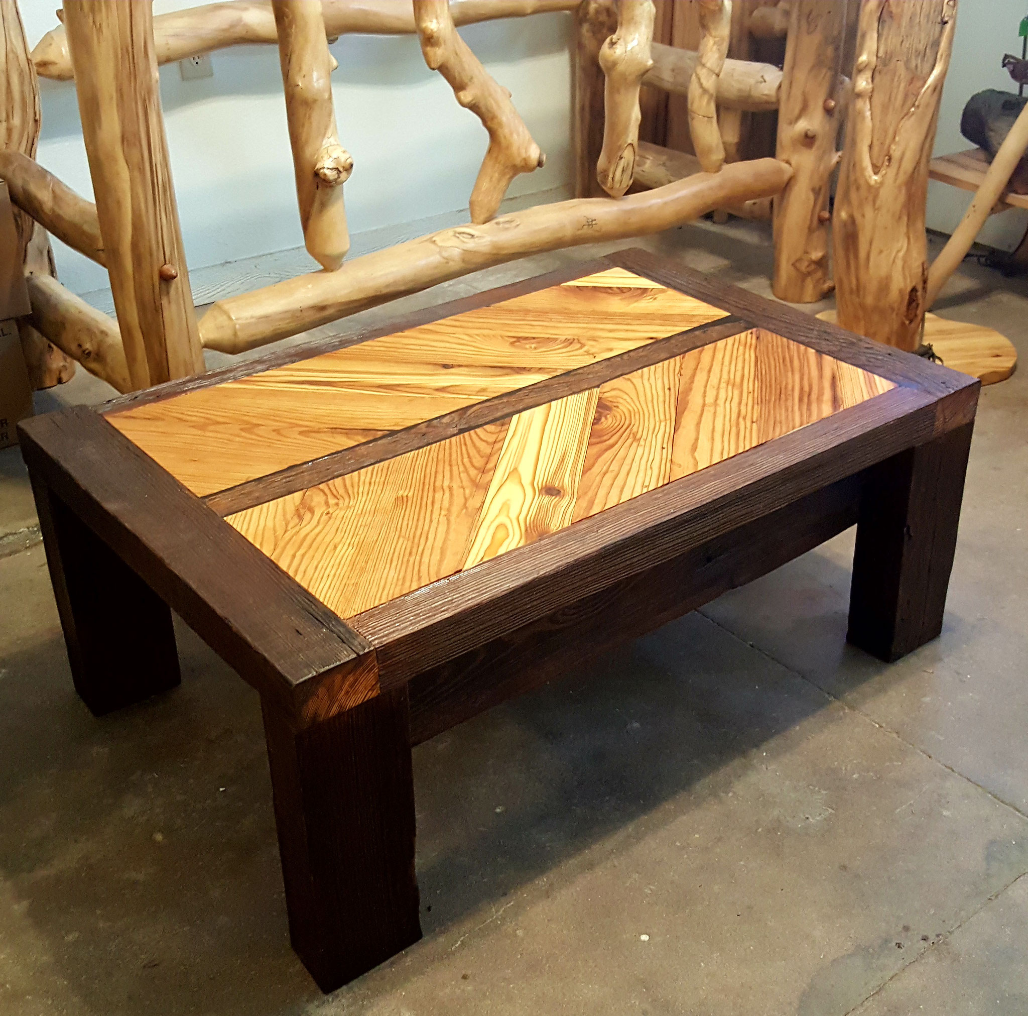 "Coffee table made using reclaimed wood taken from a 100+ year old factory in Southwest Oklahoma. This coffee table measures 45""x30""x18"" (LxWxH)."