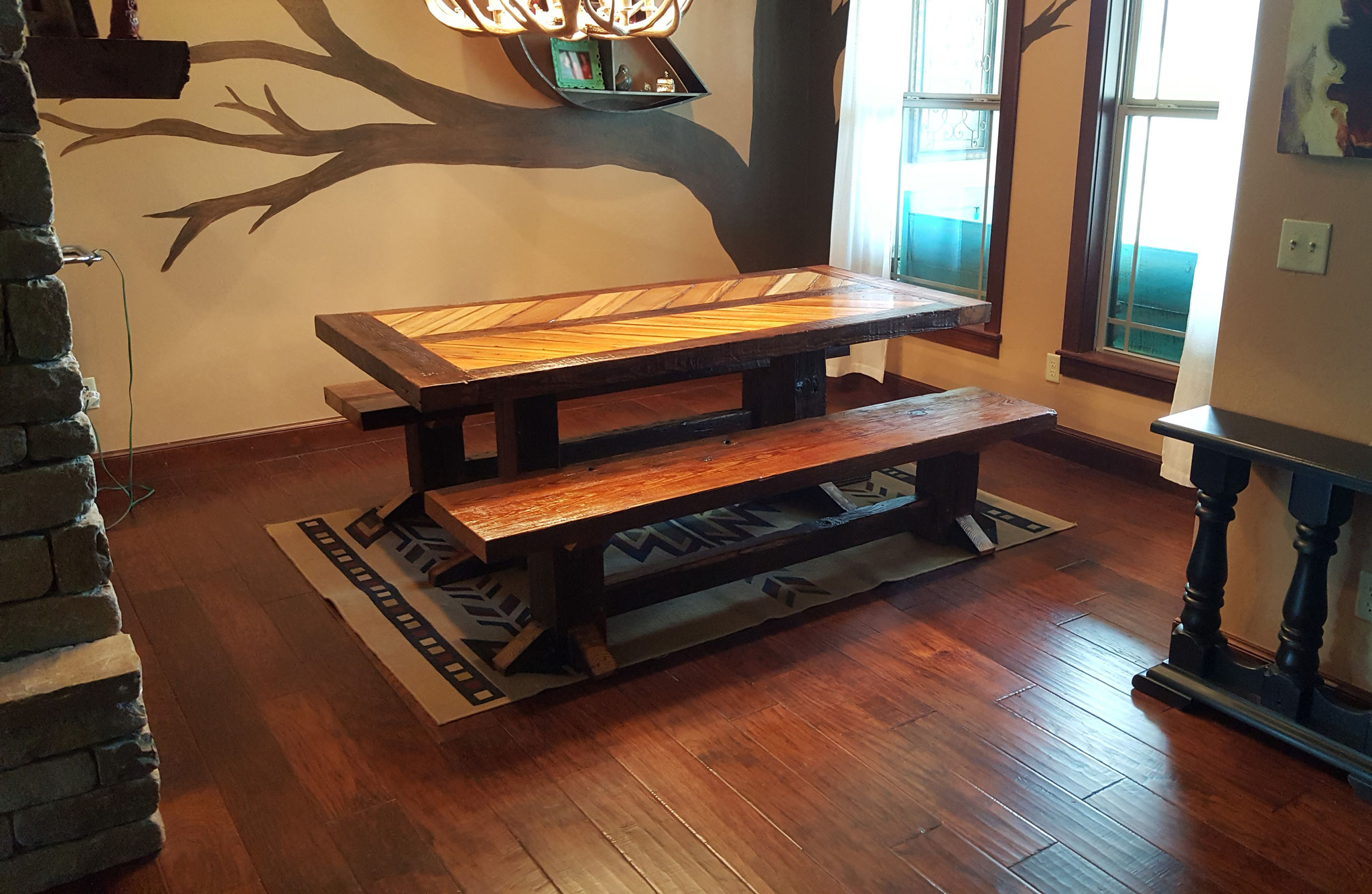 "Dining room table and benches made using reclaimed wood taken from a 100+ year old factory in southwest Oklahoma. The table measures 80""x38""x30"" (LxWxH) and the benches measure 80""x16""x18""."