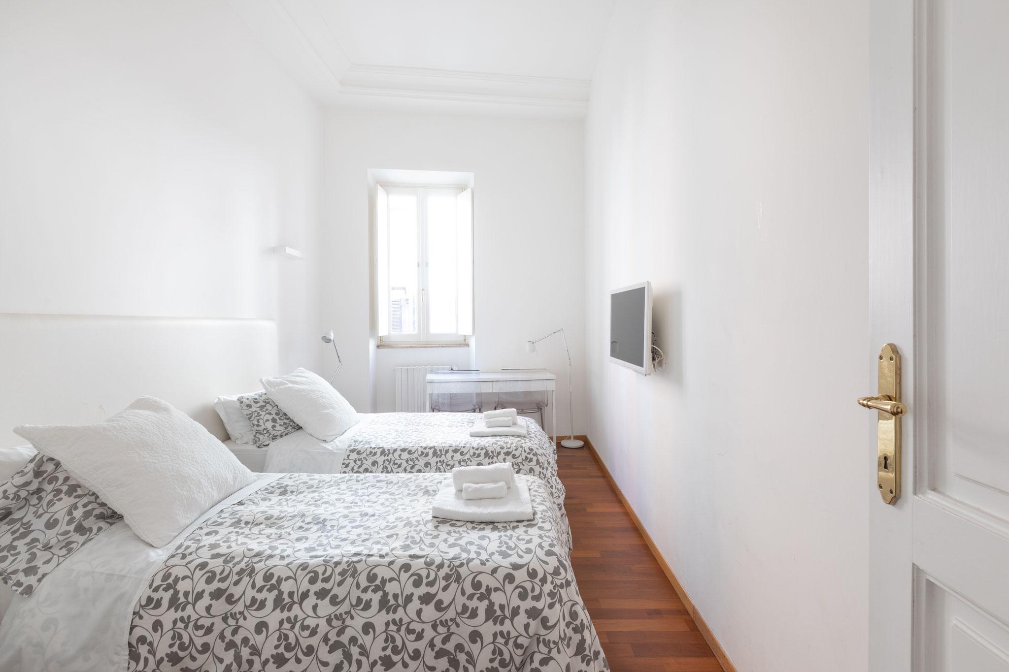 chambre double avec lits simples