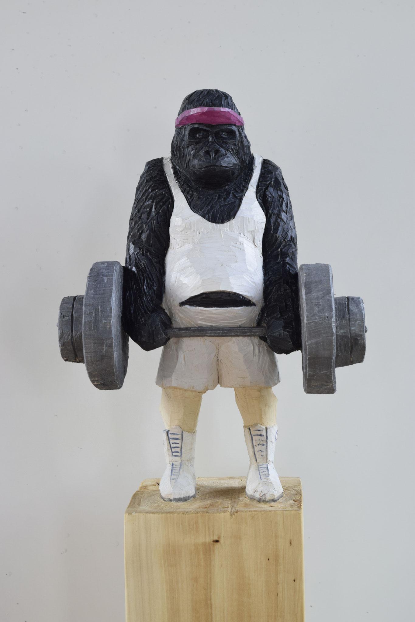 Gorilla mit Hanteln