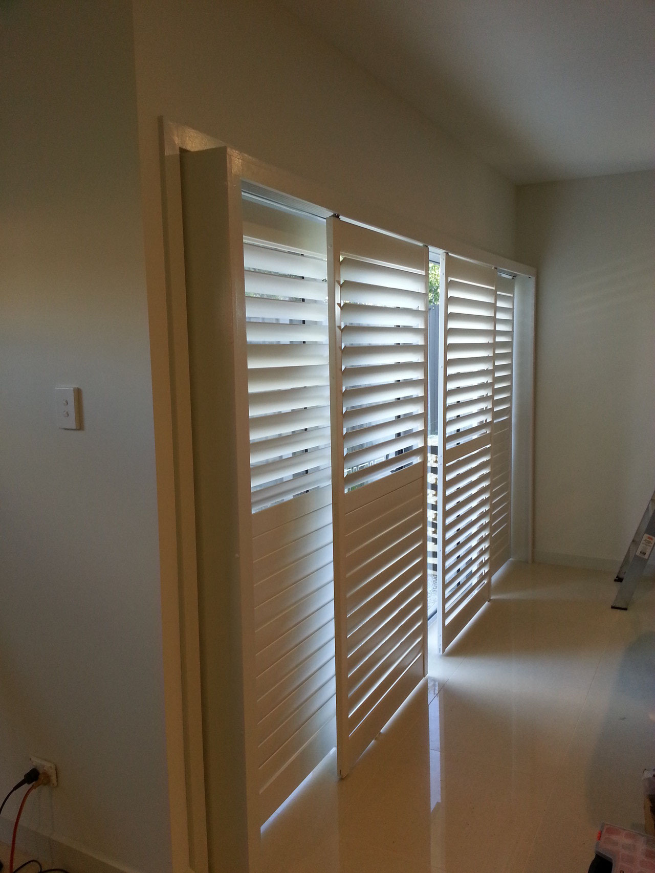 Vinyl Plantation Shutters in Sliding door