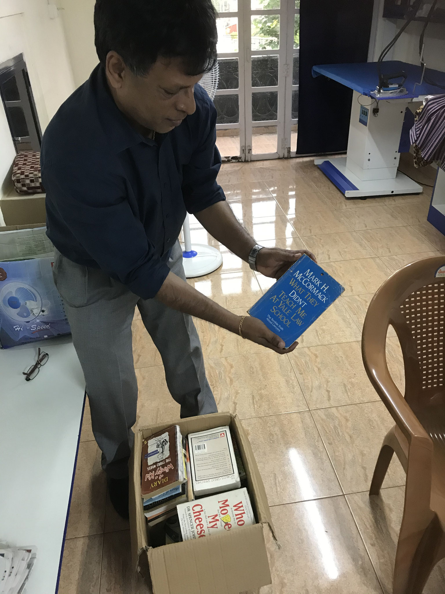 Member donating books to SCT FREE library