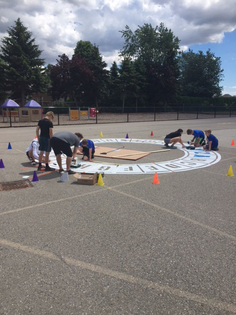 Students working on their playground stencils in Chatham, Ontario