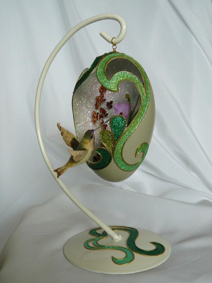 krulei met groene colibrie