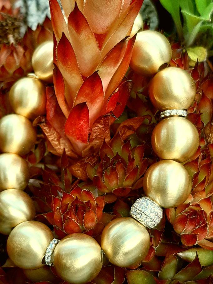 armband-silber-hartvergoldet-zirkonia-dehnbar-verschiedene kugelgroessen