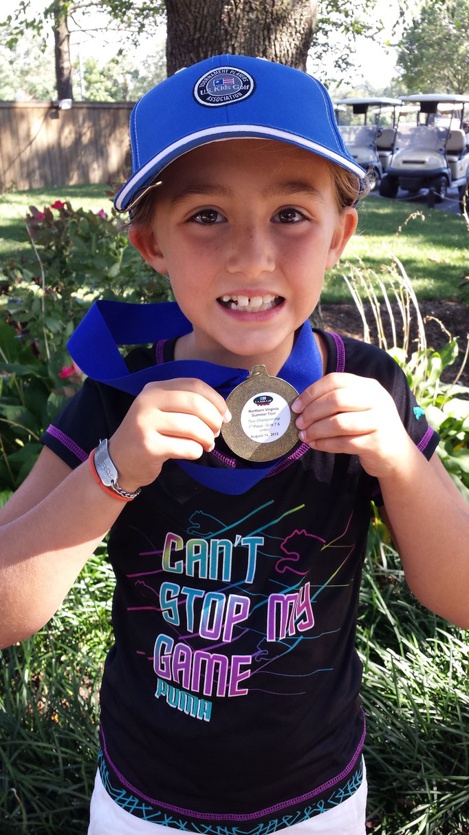 Lauren shows off her first 1st place medal at the Nova US Kids Summer Tour Championship in August 2013.