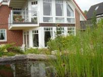 Großzügige 2-er Ferienwohnung   im EG mit sonniger Terrasse und Blick in den Naturgarten