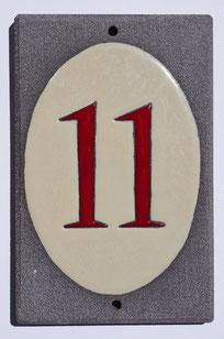 Numéro de porte beige et rouge en lave émaillée