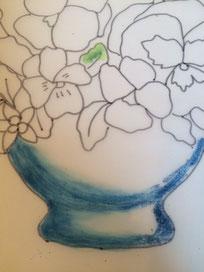 最初の直描きから左半分を筆でなじませたところです。