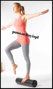 Balance auf der Pilatesrolle mit Mai-Training