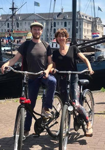 Fine Cycling guides Martin and Marloes in front of the Ship museum Amsterdam