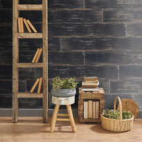 Tile that looks like painted black distressed wood on a wall in a room with rustic accessories