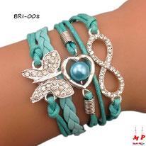 Bracelet infini vert turquoise en similicuir à breloques papillon argenté à strass, coeur perlé et symbole infini argenté