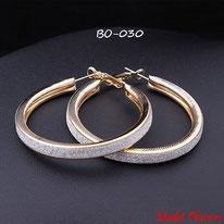 Boucles d'oreilles anneaux dorés et paillettes argentées