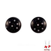 Boucles d'oreilles rondes logo étoiles blanches dans le ciel noir