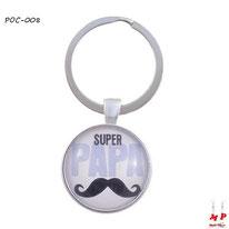 Porte-clés rond super papa à moustache noire sous cabochon en résine