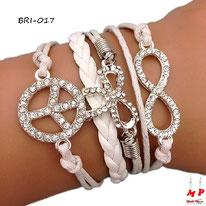 Bracelet infini blanc modèle peace and love et flot argentés sertis de strass