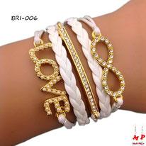 Bracelet infini blanc et doré et breloques love et barre sertie de strass