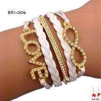 Bracelet infini blanc et doré à breloques love, barre sertie de strass blancs et infini en similicuir