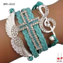 Bracelet en similicuir vert turquoise et ses symboles aile, croix et clé de sol avec strass