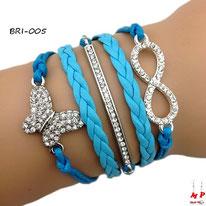 Bracelet infini bleu et breloques papillon et barre argentés à strass