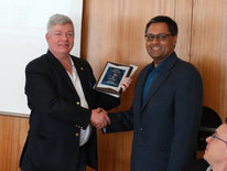 Yeti Sinh receives his Service to Cricket award from Cricket Switzerland President, Alexander Mackay