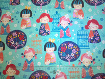 tela turquesa con muñequitas chinas