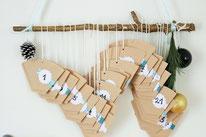 Bild: DIY Adventskalender basteln Idee - nachhaltig, upcycling und zero waste Adventskalender mit Kaffeefilter // gefunden auf www.partystories.de