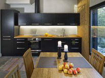 Wohnküche im Blockhaus  - Wohnblockhaus mit gemütlicher Einrichtung  - Wohngesunde Massivholzhäuser