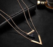 Sautoir multirang tendance  or et marbre de carrare noir