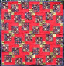 Weihnachtliche Patchworkdecke für den Tisch (rot und gold).
