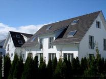 Fitze Dach AG Steildach mit Dachfenstern und Lukarnen, gedeckt mit Flachfalzziegeln