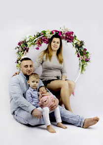 family with baby on bed