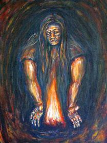 Eine Frau behuetet das Feuer