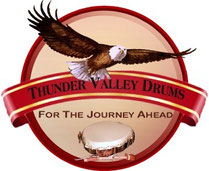 A logo for Thunder Valley Drums, a sister of Shaman Drums And More
