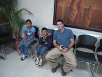 with Esbin at a doctor in Guatemala City
