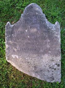 Headstone for Nathan Montgomery with the initials of carver JL near the base.