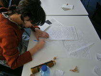 A participant of the workshop designs a geometric pattern