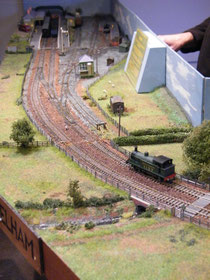 Work on wiring Elham Valley Model Railway Club's new layout