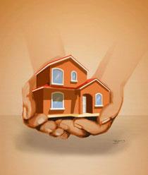 Haus wird getragen von zwei schützenden Händen