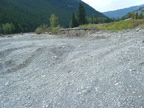This is the road that washed away. The new highway is to the right higher up the river bank.