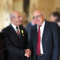 M. Guarnieri félicité par M. l'Ambassadeur.
