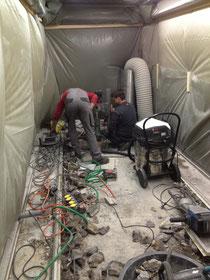 Setzen der Kernbohrungen für Strom-Gas-Wasseranschlüsse - später werden die Brandschottungen ausgeführt