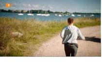 Yvonne Catterfield jogged vor der Kulisse des WSR-Bojenfeldes