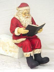 figura de Santa Claus leyendo