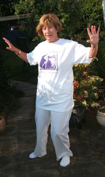 "Pam ""playing"" tai chi in the garden"