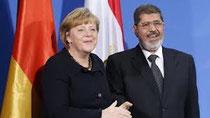 Меркель и Мурси