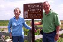 Carol Hendrickson and her brother Richard accept a new sign from the McDonough County Historical Society
